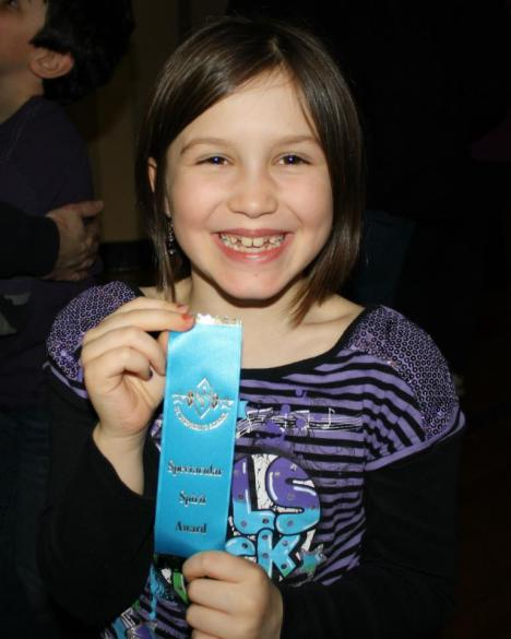 "Lil' Mo receiving a ""Spectacular Spirit"" award at her school."